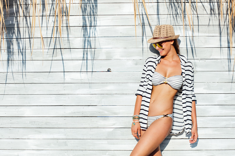 woman in striped bikini and slim abs and thighs