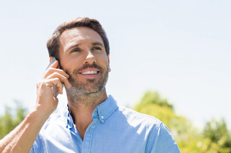 bearded man with phone