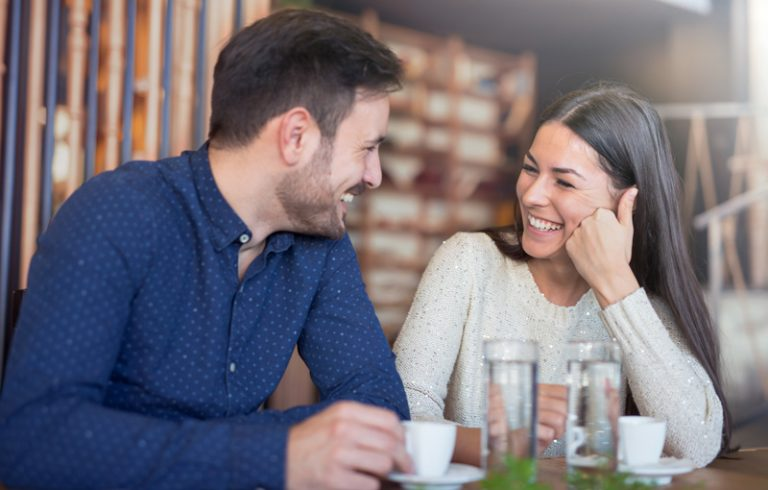 couple having coffee sharing a laugh