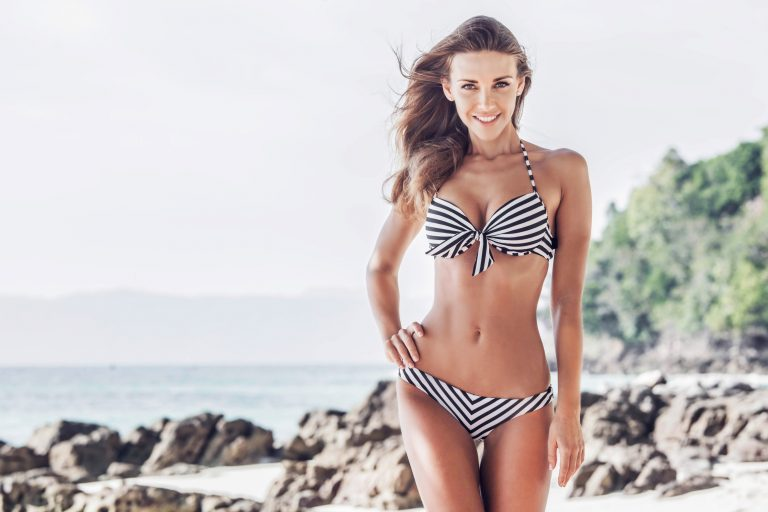 woman in striped swimsuit with hair-free bikini line