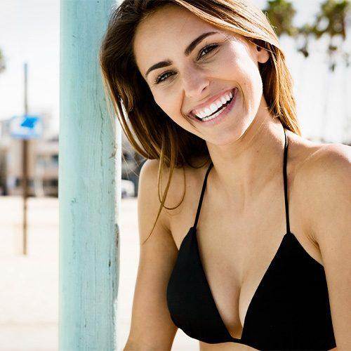 smiling woman in black bikini top